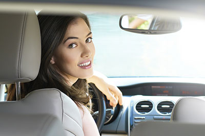 Woman looking back in car